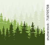 spruce forest in the hills.... | Shutterstock . vector #718705708