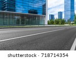 empty road and modern office...   Shutterstock . vector #718714354
