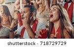 group of fans cheer for their... | Shutterstock . vector #718729729
