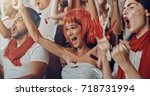 group of fans cheer for their... | Shutterstock . vector #718731994
