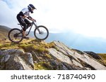a man is riding enduro bicycle  ... | Shutterstock . vector #718740490
