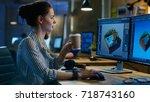 female game developer works on... | Shutterstock . vector #718743160