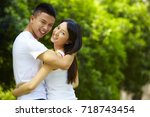 young chinese lover holding... | Shutterstock . vector #718743454