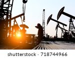 the oil workers at work | Shutterstock . vector #718744966
