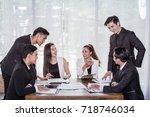 asian group businessman... | Shutterstock . vector #718746034