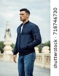 handsome male model wear jacket | Shutterstock . vector #718746730