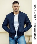 handsome male model wear jacket | Shutterstock . vector #718746736