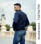 back view of handsome male... | Shutterstock . vector #718746754