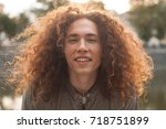 a portrait of a curly haired... | Shutterstock . vector #718751899