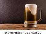 beer in mug on wooden table... | Shutterstock . vector #718763620