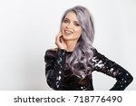 bright smiling woman with curly ... | Shutterstock . vector #718776490