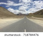 road through the mountains | Shutterstock . vector #718784476