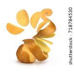 potato chips flying from pilled ...   Shutterstock . vector #718784530