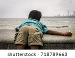 play full boy on marine drive... | Shutterstock . vector #718789663