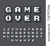 3d pixel video game 8 bit font. ... | Shutterstock .eps vector #718797346