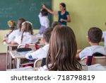 school children are... | Shutterstock . vector #718798819