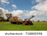 Red Tractor With A Huge Load O...