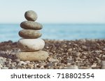 stack of balanced stones on the ... | Shutterstock . vector #718802554