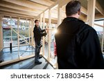 professional carpenters... | Shutterstock . vector #718803454