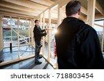 professional carpenters... | Shutterstock . vector #718803454