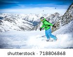 winter day and skier  | Shutterstock . vector #718806868