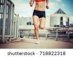 female runner jogging on the... | Shutterstock . vector #718822318