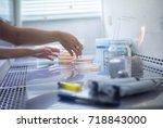 soft focus scientist hand... | Shutterstock . vector #718843000