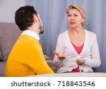 mature mother having... | Shutterstock . vector #718843546
