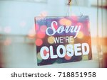 closed sign hanging front of... | Shutterstock . vector #718851958