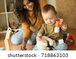 mother playing with her baby  ... | Shutterstock . vector #718863103