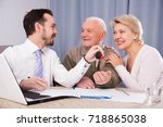 Small photo of Elderly man and manager signed contract car hire and get keys from agent