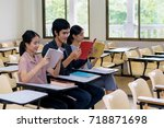 group of three students reading ...   Shutterstock . vector #718871698