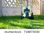 lawn mowing   mowing the lawn   ... | Shutterstock . vector #718873030