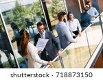 young designers talking on... | Shutterstock . vector #718873150