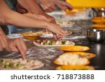 hands of people making pizzas... | Shutterstock . vector #718873888
