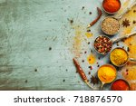 wooden table of colorful spices | Shutterstock . vector #718876570