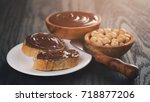 two baguette slices with... | Shutterstock . vector #718877206