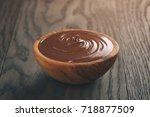 chocolate hazelnut creamin wood ...   Shutterstock . vector #718877509