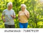 senior couple running in park  | Shutterstock . vector #718879159