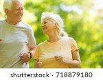 senior couple running in park  | Shutterstock . vector #718879180
