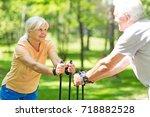 senior couple nordic walking in ...   Shutterstock . vector #718882528