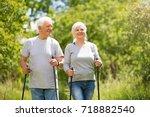 senior couple nordic walking in ... | Shutterstock . vector #718882540