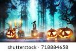 spooky halloween pumpkins on... | Shutterstock . vector #718884658