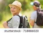 senior couple hiking    Shutterstock . vector #718886020