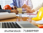 confident team of architect... | Shutterstock . vector #718889989