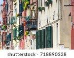 facades of residential... | Shutterstock . vector #718890328