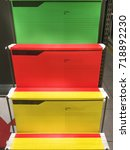 Small photo of Colorful Suspension Folders Foolscap Size Hanging on Racks