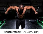 man doing a cable fly at the gym | Shutterstock . vector #718893184