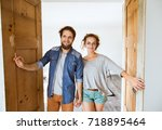 couple moving in new house ... | Shutterstock . vector #718895464