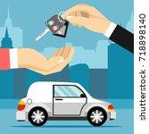car seller hand giving key to... | Shutterstock . vector #718898140